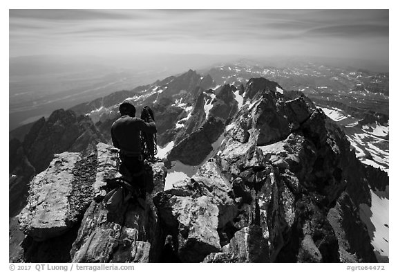 Climber coils rope on Upper Exum Ridge, Grand Teton. Grand Teton National Park (black and white)