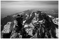 Climber coils rope on Upper Exum Ridge, Grand Teton. Grand Teton National Park ( black and white)