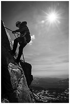 Woman climber rappelling on Grand Teton. Grand Teton National Park ( black and white)