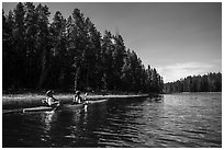 Kayakers in forested inlet, Colter Bay. Grand Teton National Park ( black and white)