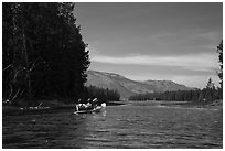 Kayakers approach narrow channel, Colter Bay. Grand Teton National Park ( black and white)
