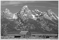 Moulton Barn and Grand Tetons, morning. Grand Teton National Park, Wyoming, USA. (black and white)