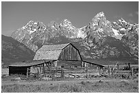 Historic Moulton Barn and Tetons mountain range, morning. Grand Teton National Park, Wyoming, USA. (black and white)