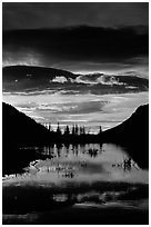 Sunrise with colorful clouds reflected on a pond in Horseshoe park. Rocky Mountain National Park, Colorado, USA. (black and white)