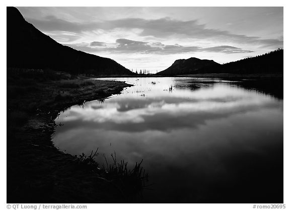 Pond with cloud reflexion at sunrise, Horsehoe Park. Rocky Mountain National Park (black and white)