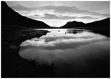 Pond with cloud reflection at sunrise, Horsehoe Park. Rocky Mountain National Park, Colorado, USA. (black and white)
