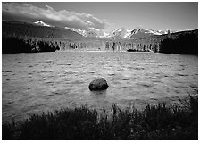 Rippled water in Sprague Lake, and snowy mountain range. Rocky Mountain National Park ( black and white)