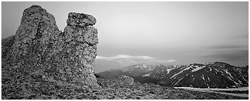 Rock towers on high pass and mountains at dusk. Rocky Mountain National Park (Panoramic black and white)