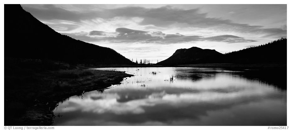 Cloud reflected in pond at sunrise. Rocky Mountain National Park (black and white)