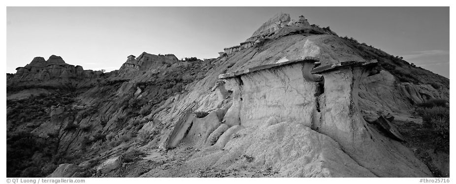 Badlands scenery with caprocks. Theodore Roosevelt National Park (black and white)