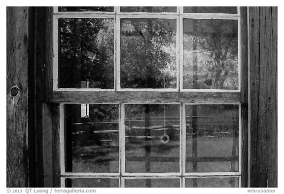 Badlands reflected in Maltese Cross cabin window. Theodore Roosevelt National Park (black and white)