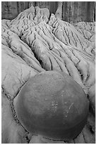 Spherical cannonball concretion in badlands. Theodore Roosevelt National Park, North Dakota, USA. (black and white)