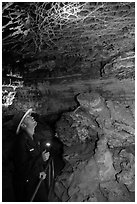 Ranger lights up boxwork in the Elks Room. Wind Cave National Park ( black and white)