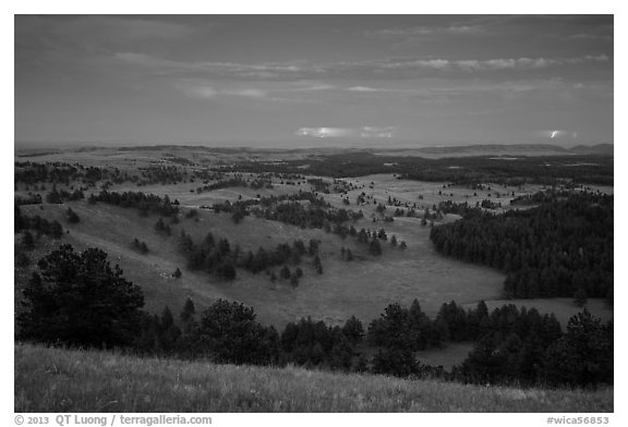 Rolling hills with distant lightening storm at dusk. Wind Cave National Park (black and white)