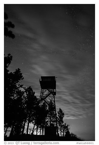 Rankin Ridge tower at dusk and starry sky. Wind Cave National Park (black and white)