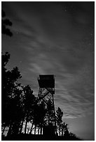 Rankin Ridge tower at dusk and starry sky. Wind Cave National Park ( black and white)