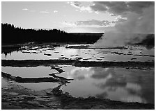 Great Fountain Geyser with residual steam at sunset. Yellowstone National Park ( black and white)