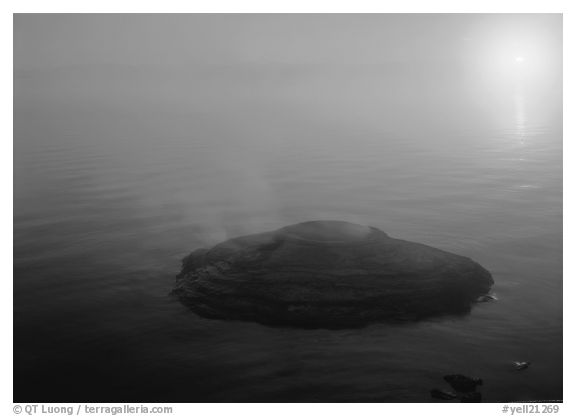 Fishing cone, fog, and  sun rising. Yellowstone National Park (black and white)