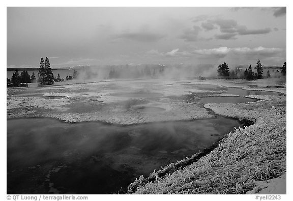 West Thumb Geyser Basin covered by snow at dusk. Yellowstone National Park (black and white)