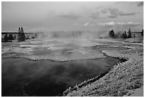 West Thumb Geyser Basin covered by snow at dusk. Yellowstone National Park, Wyoming, USA. (black and white)