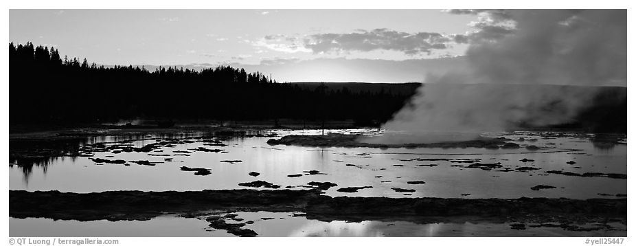 Steam rising in geyser pool at sunset. Yellowstone National Park (black and white)