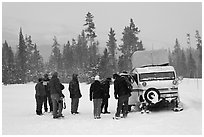 Travelers boarding snow bus. Yellowstone National Park, Wyoming, USA. (black and white)