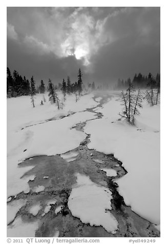 Colorful thermal stream and dark clouds, winter. Yellowstone National Park (black and white)