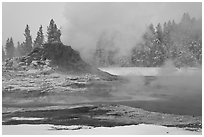 Castle geyser cone and steam in winter. Yellowstone National Park, Wyoming, USA. (black and white)