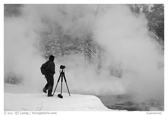 Photographer standing next to hot springs. Yellowstone National Park (black and white)