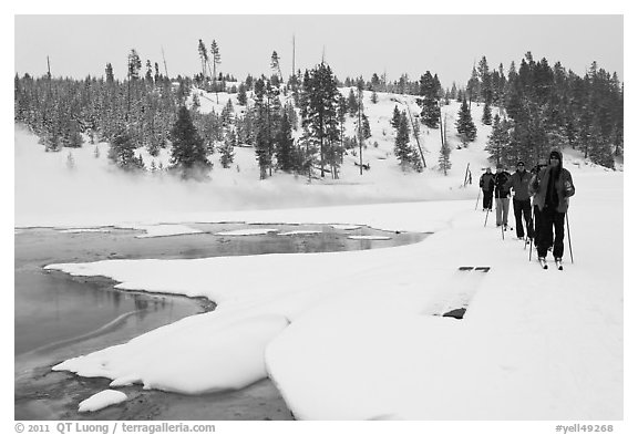 Cross country skiers pass Chromatic Spring. Yellowstone National Park (black and white)