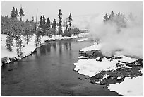 Thermal steam along the Firehole River in winter. Yellowstone National Park, Wyoming, USA. (black and white)