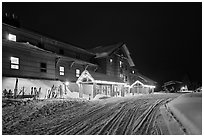 Old Faithful Snow Lodge at night, winter. Yellowstone National Park, Wyoming, USA. (black and white)