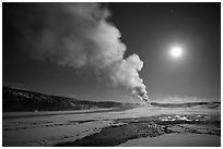 Old Faithful Geyser eruption and moon. Yellowstone National Park ( black and white)
