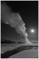 Night view of Old Faithful Geyser in winter with full moon. Yellowstone National Park ( black and white)