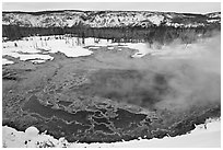 Gem pool seen from above, winter. Yellowstone National Park, Wyoming, USA. (black and white)