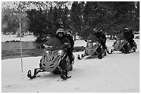 Snowmobile riders. Yellowstone National Park, Wyoming, USA. (black and white)