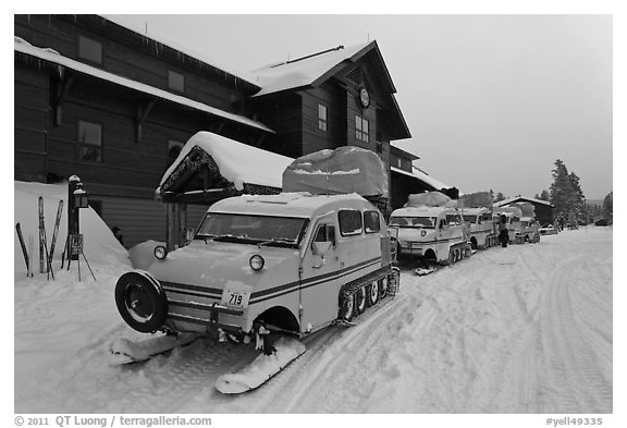 Snow busses in front of Old Faithful Snow Lodge. Yellowstone National Park (black and white)