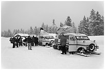 Winter tour snow coaches unloading, Flagg Ranch. Yellowstone National Park, Wyoming, USA. (black and white)