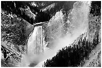 Mist raising from falls of the Yellowstone river. Yellowstone National Park, Wyoming, USA. (black and white)