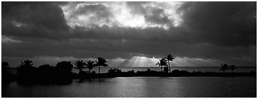 Sunrise with dark clouds over coastal lagoon. Biscayne National Park (Panoramic black and white)