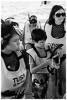 Family preparing for snorkeling. Biscayne National Park, Florida, USA. (black and white)