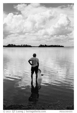 Fisherman holding net. Biscayne National Park (black and white)