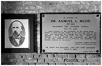 Plate commemorating Dr Mudd's imprisonment. Dry Tortugas National Park, Florida, USA. (black and white)