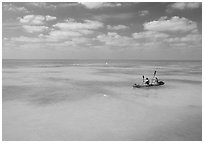Sea kayakers in turquoise waters. Dry Tortugas National Park, Florida, USA. (black and white)