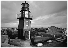 Lighthouse and cannon on upper level of Fort Jefferson. Dry Tortugas National Park, Florida, USA. (black and white)