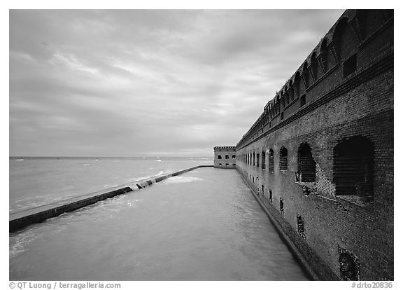 Fort Jefferson wall overlooking the ocean, cloudy weather. Dry Tortugas  National Park (black and white)