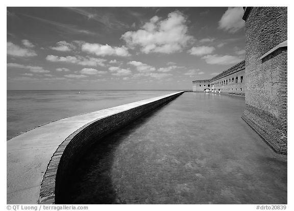 Seawall, moat, and rampart on a calm sunny day, Fort Jefferson. Dry Tortugas National Park (black and white)