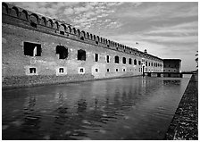 Fort Jefferson moat, walls and lighthouse. Dry Tortugas National Park, Florida, USA. (black and white)