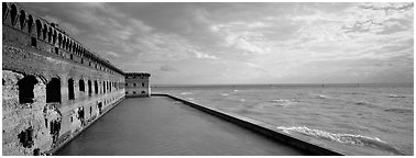 Seascape with fort and seawall. Dry Tortugas National Park (Panoramic black and white)
