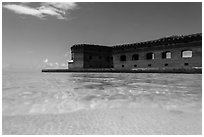 Split view of Fort Jefferson and clear sandy bottom. Dry Tortugas National Park, Florida, USA. (black and white)
